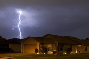 Lightning strike at night very near homes